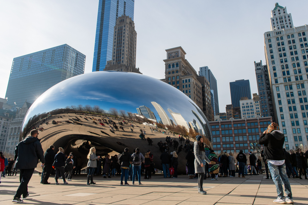 "Dozens of people visit and take pictures of Cloud Gate or ""The Bean"" at Millennium Park, in the Loop."