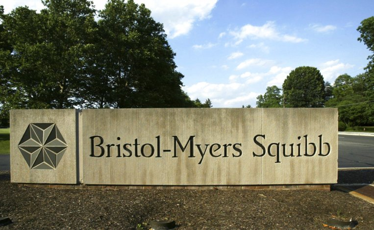 a sign stands in front of a Bristol-Myers Squibb building