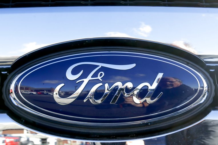 the blue Ford oval badge in the grill of a pickup truck