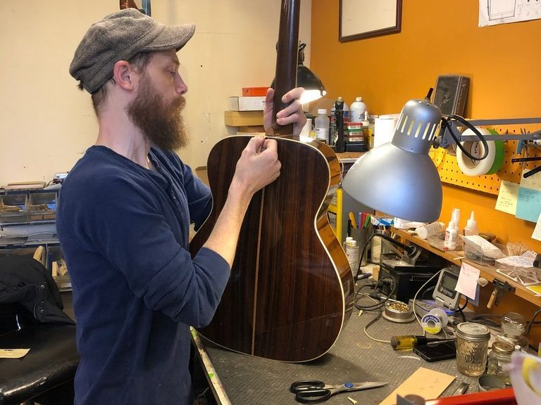 Chicago Fret Works technician Joe Swierupski was the first employee hired more than seven years ago at the shop. | Ji Suk Yi for the Sun-Times