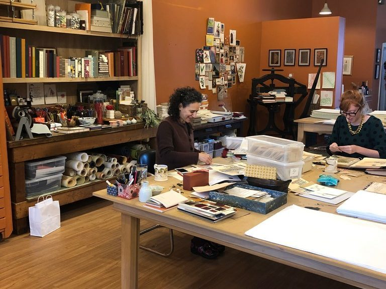 Bari Zaki (left), owner of Bari Zaki Studio, works on a project. Zaki has over 30 years experience in European and Japanese bookbinding techniques. She also creates custom boxes and portfolios. | Ji Suk Yi for the Sun-Times