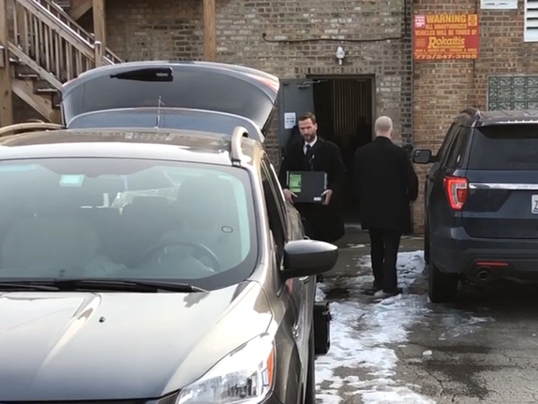 Agents carrying items out of Ald. Ed Burke's 14th Ward office