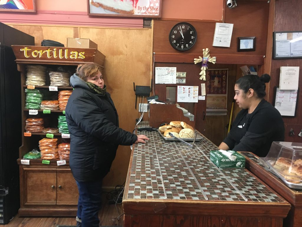 Maria Beltran paying for her bolillos and conchas at Panaderia Nuevo Leon on Wednesday.