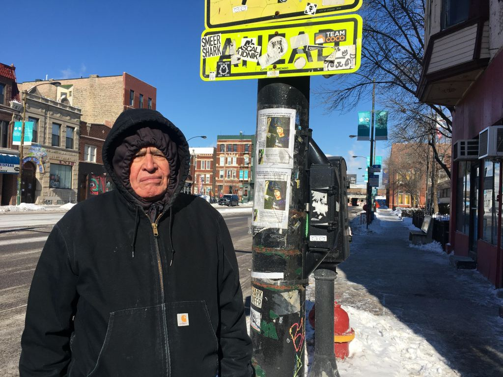 Pablo Camacho, 78, on his way home after a trip to the grocery store on Wednesday morning in Pilsen.