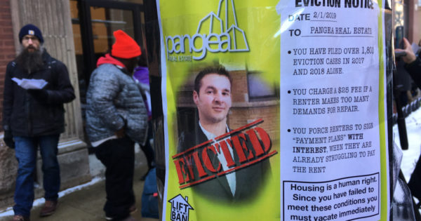 Protesters hand 'eviction' notice to Pangea Properties, push for rent control