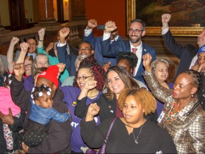 State Rep. Will Guzzardi joins activists on the Capitol rotunda after the bill to raise the state's minimum wage to $15 by 2025 passed the Illinois House on Thursday afternoon. The legislation, sponsored by Guzzardi, a Chicago Democrat, passed along partisan lines 69-47-1. (Capitol News Illinois photo by Jerry Nowicki)