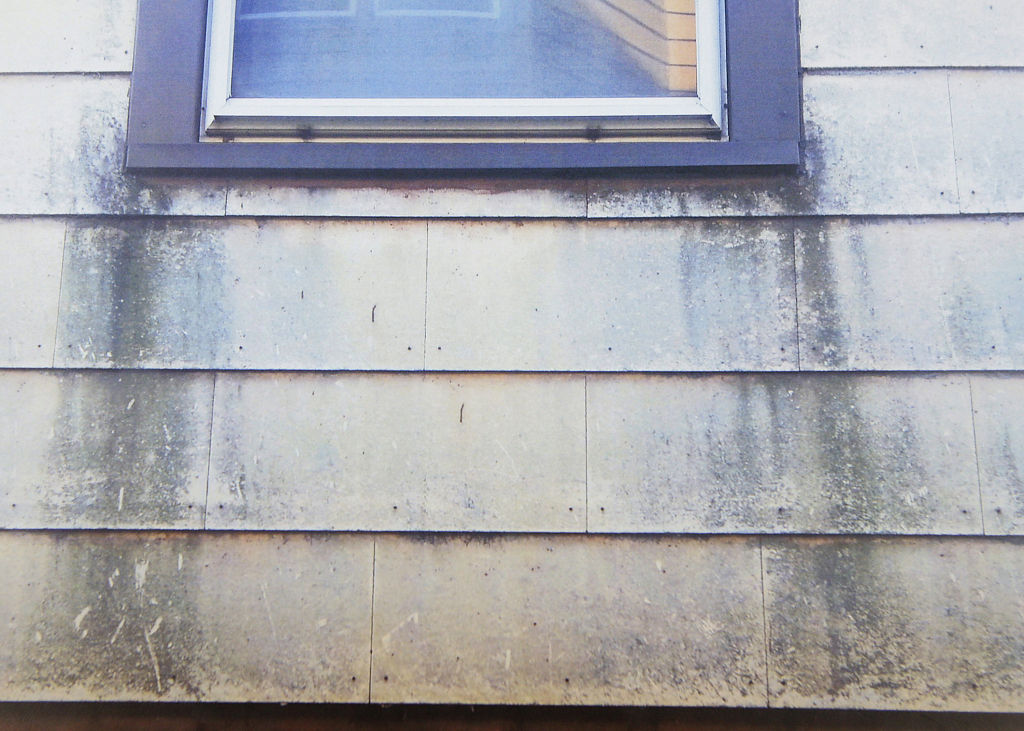 Dust buildup is shown on a house in the 10th Ward
