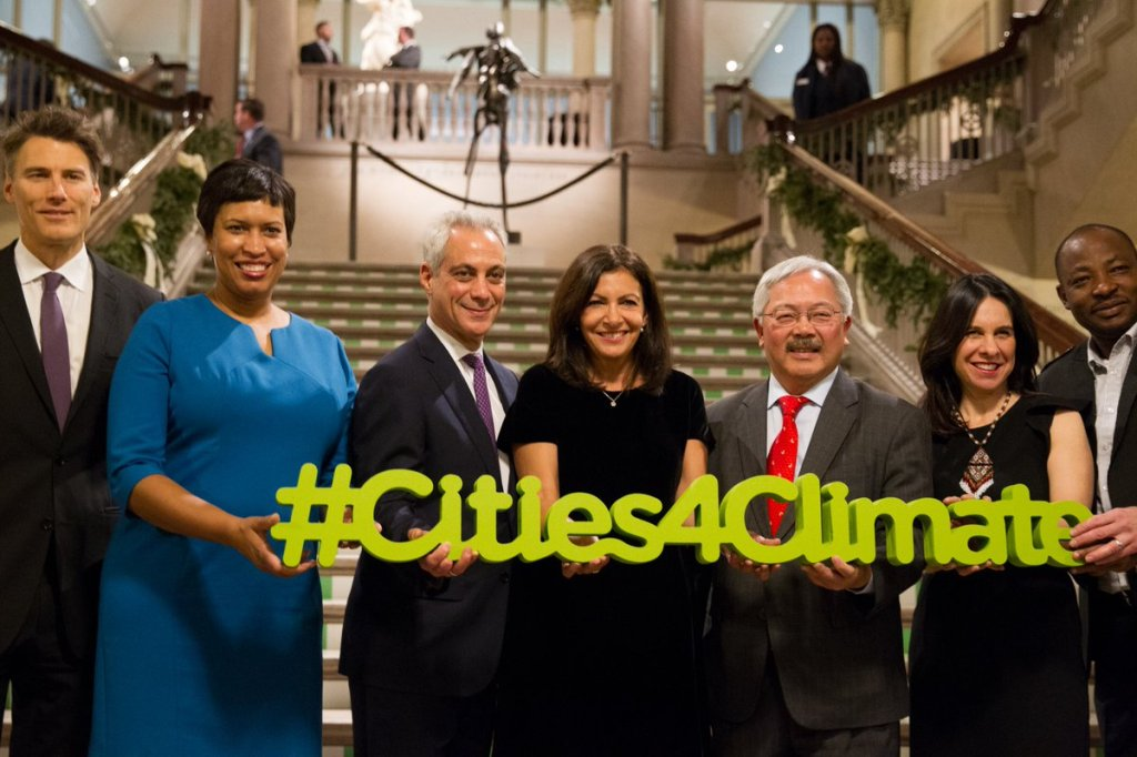 Mayor Rahm Emanuel is flanked by city leaders from around the world at the North American Climate Summit in Chicago in 2017.