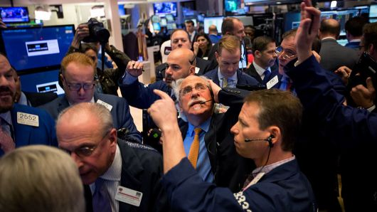Traders work on the floor of the New York Stock Exchange (NYSE) in New York, U.S., on Wednesday, Nov. 9, 2016.