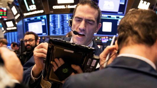 Traders work on the floor of the New York Stock Exchange (NYSE) in New York, U.S., on Wednesday, Jan. 2, 2019.