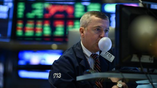A trader makes a bubble with a chewing gum ahead of the closing bell on the floor of the New York Stock Exchange (NYSE) on January 29, 2019 in New York City.