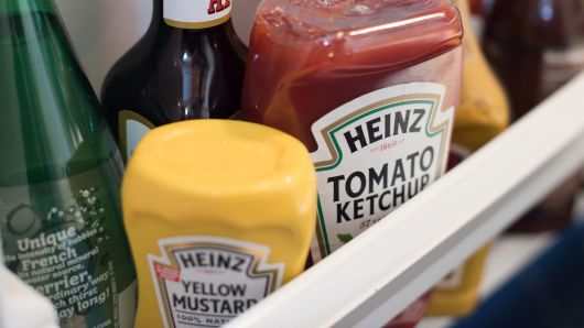 Bottles of Heinz Kraft Co. Heinz brand Tomato Ketchup and Yellow Mustard are arranged for a photograph in Dobbs Ferry, New York, on Wednesday, Feb. 20, 2019.