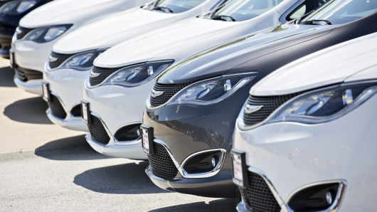 A row of Fiat Chrysler Automobiles (FCA) 2017 Crysler Pacifica minivan vehicles are displayed for sale at a car dealership in Moline, Illinois, on Saturday, July 1, 2017.