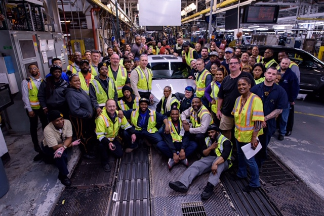 Ford workers on Friday gather around the last of 8 million or so Taurus sedans produced at its Chicago Assembly plant, at 130th and Torrence Avenue, over the past 34 years. The company is phasing out production of most of its cars in favor of SUV-type vehicles.   Provided photo