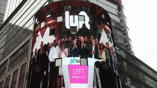 Signage for Lyft is seen displayed at the NASDAQ MarketSite in Times Square in celebration of its initial public offering (IPO) on the NASDAQ Stock Market in New York, U.S., March 29, 2019.