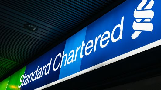 Signage for Standard Chartered Plc is displayed outside a bank branch in Hong Kong, China, on Saturday, Feb 16, 2019.