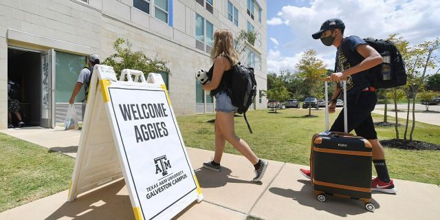 FILE - Evacuated students from Texas A&M University at Galveston are welcomed at Aloft College Station on Tuesday, Aug. 25, 2020, in College Station, Texas. Hurricane Laura is expected to make landfall late Wednesday or early Thursday. (Laura McKenzie/College Station Eagle via AP)