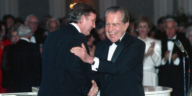 In this March 11, 1989, photo Donald Trump shakes hands with former President Richard Nixon at a tribute gala to Nellie Connally at the Westin Galleria ballroom in Houston, Texas. (Richard Carson/Houston Chronicle via AP)