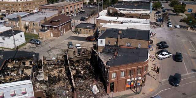 This Aug. 28, 2020 aerial photo shows damage to businesses in Kenosha, Wis. Police in Kenosha have arrested dozens of people since a white officer shot Jacob Blake in the back. (Sean Krajacic/The Kenosha News via AP)