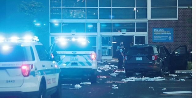 Police officers inspect a damaged Best Buy store in Chicago after parts of the city suffered from widespread looting and vandalism over the summer. (Getty Images)