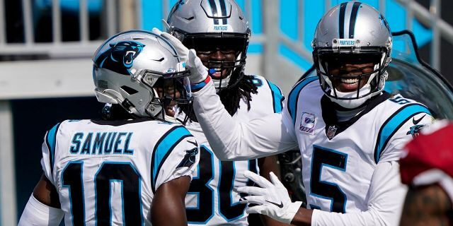 Carolina Panthers quarterback Teddy Bridgewater, right, and wide receiver Curtis Samuel celebrates after a touchdown by tight end Ian Thomas (80) during the second half of an NFL football game against the Arizona Cardinals Sunday, Oct. 4, 2020, in Charlotte, N.C. (AP Photo/Brian Blanco)
