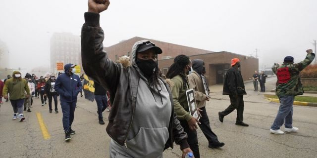 People march during a protest rally for Marcellis Stinnette who was killed by Waukegan Police last Tuesday in Waukegan, Ill., Thursday, Oct. 22, 2020. (AP Photo/Nam Y. Huh)