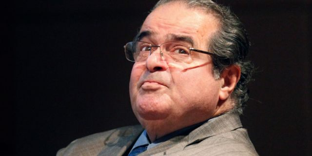 FILE - In this Oct. 18, 2011 file photo, U.S. Supreme Court Justice Antonin Scalia looks into the balcony before addressing the Chicago-Kent College Law justice in Chicago. (AP Photo/Charles Rex Arbogast, File)