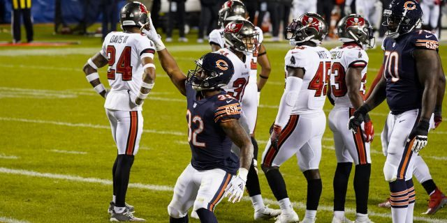 Chicago Bears running back David Montgomery (32) celebrates a touchdown against the Tampa Bay Buccaneers during the first half of an NFL football game in Chicago, Thursday, Oct. 8, 2020. (AP Photo/Nam Y. Huh)