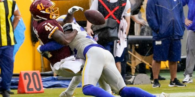 Los Angeles Rams' Jordan Fuller breaks up a pass intended for Washington Football Team's J.D. McKissic during the second half of an NFL football game Sunday, Oct. 11, 2020, in Landover, Md. (AP Photo/Steve Helber)
