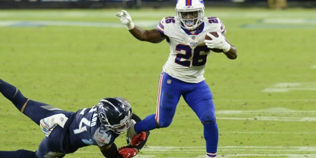 Buffalo Bills running back Devin Singletary (26) gets away from Tennessee Titans strong safety Kenny Vaccaro (24) in the second half of an NFL football game Tuesday, Oct. 13, 2020, in Nashville, Tenn. (AP Photo/Mark Zaleski)