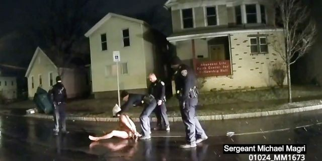"""In this image taken from police body camera video provided by Roth and Roth LLP on Sept. 2, 2020, a Rochester police officer puts a """"spit hood"""" over the head of Daniel Prude, on March 23, 2020, in Rochester, N.Y. (Rochester Police via Roth and Roth LLP via AP, File)"""