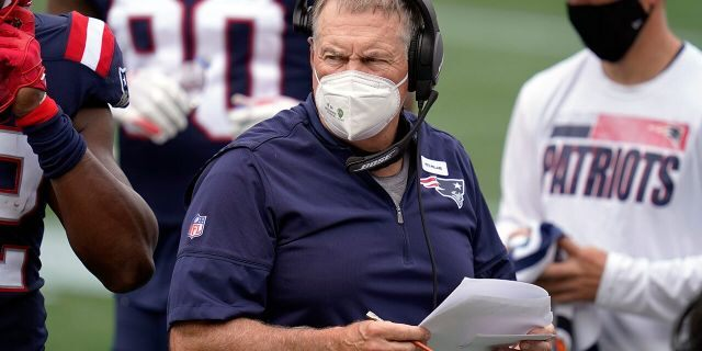 New England Patriots head coach Bill Belichick works along the sideline in the first half of an NFL football game against the Las Vegas Raiders, Sunday, Sept. 27, 2020, in Foxborough, Mass. (AP Photo/Charles Krupa)