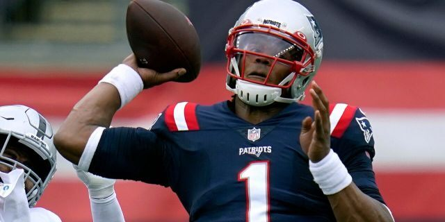 New England Patriots quarterback Cam Newton (1) passes under pressure in the first half of an NFL football game against the Las Vegas Raiders, Sunday, Sept. 27, 2020, in Foxborough, Mass. (AP Photo/Charles Krupa)