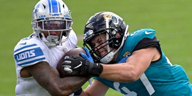 Detroit Lions running back D'Andre Swift, left, is tackled by Jacksonville Jaguars linebacker Joe Schobert after a short gain during the first half of an NFL football game, Sunday, Oct. 18, 2020, in Jacksonville, Fla. (AP Photo/Phelan M. Ebenhack)