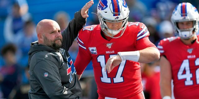 FILE - In this Oct. 20, 2019, file photo, Buffalo Bills offensive coordinator Brian Daboll, left, encourages quarterback Josh Allen as he warms up before an NFL football game Miami Dolphins, Sunday, Oct. 20, 2019, in Orchard Park, N.Y. (AP Photo/Adrian Kraus, File)