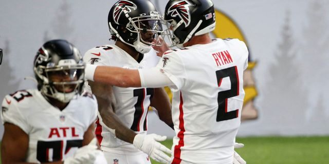 Atlanta Falcons wide receiver Julio Jones, left, celebrates with teammate Matt Ryan (2) after catching a 20-yard touchdown pass during the first half of an NFL football game against the Minnesota Vikings, Sunday, Oct. 18, 2020, in Minneapolis. (AP Photo/Bruce Kluckhohn)