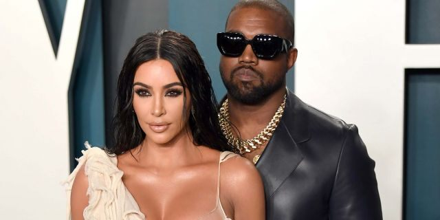 Kim Kardashian (left) said she helped take care of her husband Kanye West (right) while he was battling coronavirus earlier this year. (Photo by Karwai Tang/Getty Images)