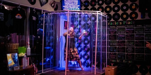 """Tracie England, the owner of Tracie's Place Karaoke Bar and Restaurant, says the reaction to the """"shower stall"""" idea has been positive."""