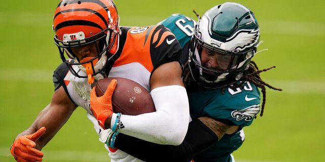 Cincinnati Bengals' Tyler Boyd, left, is tackled by Philadelphia Eagles' Avonte Maddox during the second half of an NFL football game, Sunday, Sept. 27, 2020, in Philadelphia. (AP Photo/Chris Szagola)