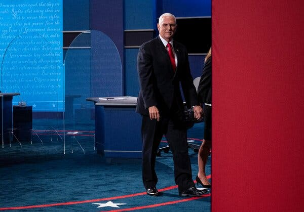 Vice President Mike Pence leaves the stage after he and Senator Kamala Harris faced off in a debate at the University of Utah.