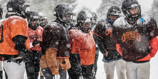 Members of the Osseo High School team practiced outside in the heavy snow in preparation for their Friday night game against Totino-Grace, Tuesday, Oct. 20, 2020, in Maple Grove, Minn.