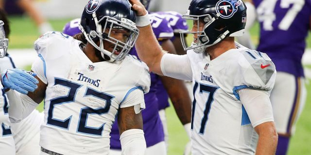 Tennessee Titans running back Derrick Henry (22) celebrates with teammate Ryan Tannehill, right, after scoring on a 1-yard touchdown run during the second half of an NFL football game against the Minnesota Vikings, Sunday, Sept. 27, 2020, in Minneapolis. (AP Photo/Bruce Kluckhohn)