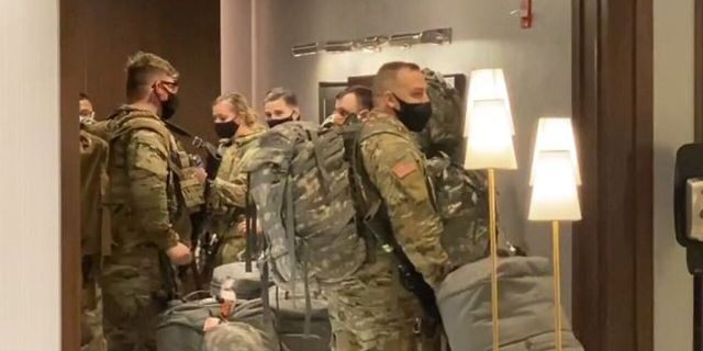 An undisclosed number of National Guard troops arrived in Chicago on Monday night in advance of any election-related civil unrest.