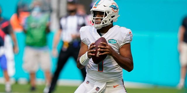 Miami Dolphins quarterback Tua Tagovailoa (1) looks to pass, during the first half of an NFL football game against the Los Angeles Rams, Sunday, Nov. 1, 2020, in Miami Gardens, Fla. (AP Photo/Wilfredo Lee)