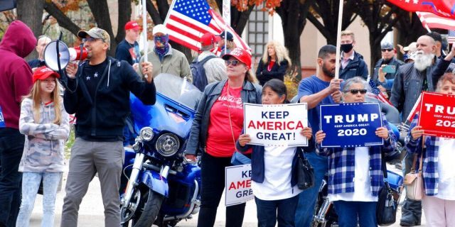 Hundreds of supporters of President Trump stage a defiant rally outside the New Mexico state Capitol building in Santa Fe, N.M., on Saturday, Nov. 7, 2020. (Associated Press)
