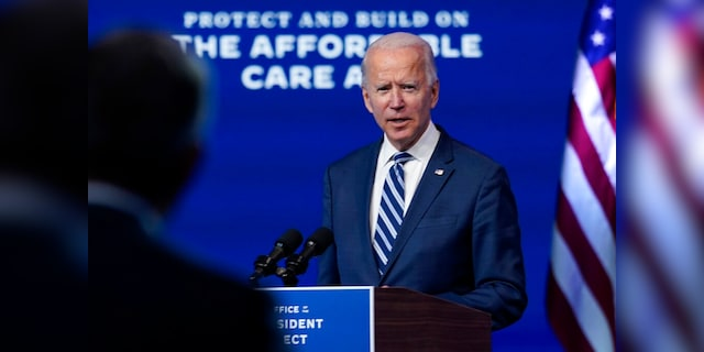 President-elect Joe Biden answers a reporter's question at The Queen theater, Nov. 10, in Wilmington, Del. (AP Photo/Carolyn Kaster)