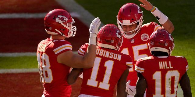 Kansas City Chiefs' Nick Keizer (48), Demarcus Robinson (11), Tyreek Hill (10) and Patrick Mahomes (15), celebrate a touchdown scored on a catch by Robinson in the second half of an NFL football game agains the New York Jets on Sunday, Nov. 1, 2020, in Kansas City, Mo. (AP Photo/Charlie Riedel)