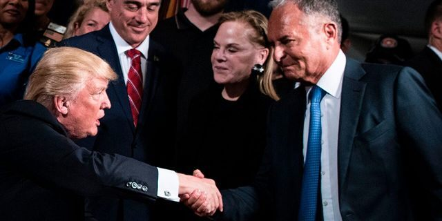 US President Donald Trump shakes Ike Perlmutter, CEO of Marvel Entertainment, hand before signing an executive order at the US Department of Veterans Affairs April 27, 2017 in Washington, DC. / AFP PHOTO / Brendan Smialowski (Photo credit should read BRENDAN SMIALOWSKI/AFP via Getty Images)