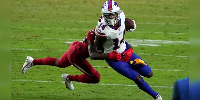 FILE- In this Sunday, Nov. 15, 2020, file photo, Buffalo Bills wide receiver Stefon Diggs (14) tries to turn upfield after a reception during an NFL football game against the Arizona Cardinals, in Glendale, Ariz. (AP Photo/Rick Scuteri, File)