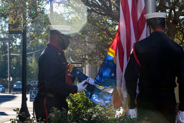 Members of a fire department honor guard unfurling the new Mississippi state flag in Hattiesburg last week.